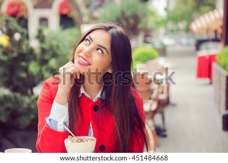 Daydreaming. Closeup portrait charming smiling joyful happy young woman looking upwards thinking of something nice, coffee shop outdoors background. Positive human emotions facial expressions feelings - stock photo