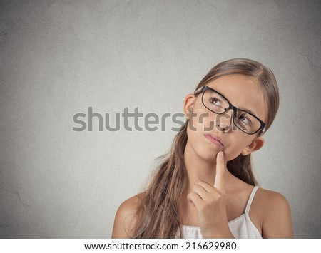 Daydreaming, confused. Closeup portrait, headshot thinking girl finger on lips gesture, looking up, isolated grey wall background. Human facial expression, emotions, feelings, life perception - stock photo