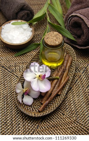 Dayspa on bamboo on rattan basket texture - stock photo