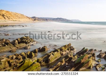 Daytime long exposure of Santa Marianita beach, central Ecuadorian coast - stock photo