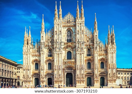 Daytime view of famous Milan Cathedral (Duomo di Milano) on piazza in Milan, Italy  - stock photo