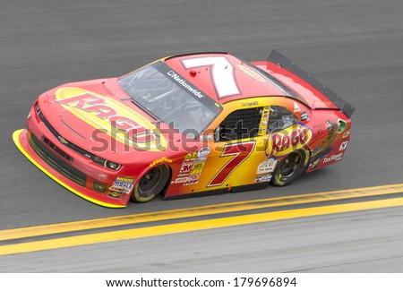 DAYTONA BEACH, FL - FEB 22, 2014:  Regan Smith (7) rest of the field to win the DRIVE4COPD 300 at Daytona International Speedway in Daytona Beach, FL. - stock photo