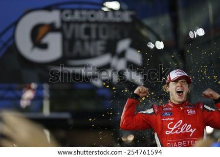 Daytona Beach, FL - Feb 20, 2015:  Ryan Reed (16) celebrates his first win, winning the Alert Today Florida 300 at Daytona International Speedway in Daytona Beach, FL. - stock photo
