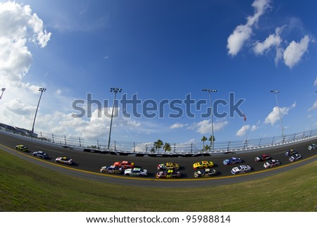 DAYTONA BEACH, FL - FEB. 23:  The NASCAR Sprint Cup teams take to the track for the Gatorade Duel 2 race at the Daytona International Speedway in Daytona Beach, FL on Feb 23, 2012. - stock photo