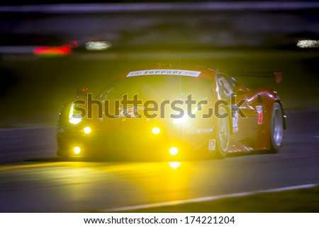 Daytona Beach, FL - Jan 23, 2014:  The Risa Competizione Ferrari goes through the turns during a practice session for the Rolex 24 at Daytona at Daytona International Speedway in Daytona Beach, FL. - stock photo