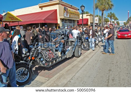 "DAYTONA BEACH, FL - MARCH 6: An custom chopper parked in front of Dirty Harry's on  Main Street during ""Bike Week 2010"" in Daytona Beach, Florida."