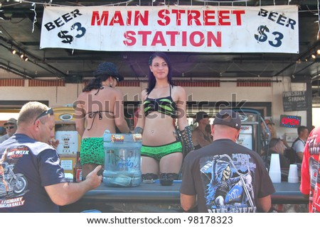 "DAYTONA BEACH, FL - MARCH 17:  Barmaids celebrate St. Patrick's Day on Main Street amid the sea of bikers in town for ""Bike Week 2012"" in Daytona Beach, Florida. March 17, 2012"