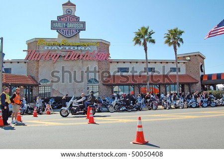 "DAYTONA BEACH, FL - MARCH 6:  Daytona Beach Harley-Davidson store is one hot spot for bikers in town for ""Bike Week 2010"" in Daytona Beach, Florida. - stock photo"