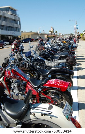 "DAYTONA BEACH, FL - MARCH 6:  Motorcycles line Beach Street for miles during during ""Bike Week 2010"" in downtown Daytona Beach, Florida."