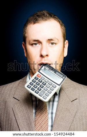 Dazed tired accountant dangles a calculator out of his mouth after crunching endless numbers to find a solution to debt and improve cash flow liquidity in a credit crunch or financial struggle concept - stock photo