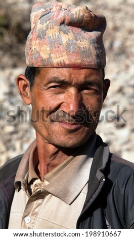 DDOGADI VILLAGE, WESTERN NEPAL, 30TH NOVEMBER 2013 - Nepal man with typical nepali hat on head