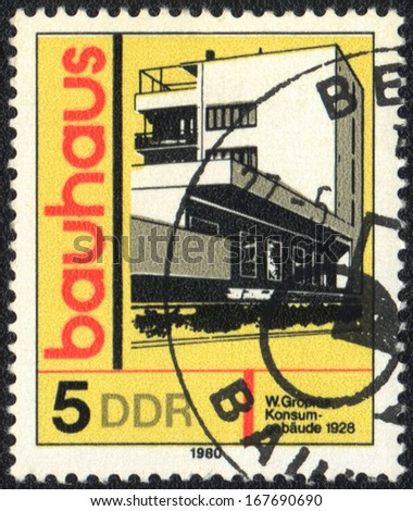 DDR- CIRCA 1980: A stamp printed in DDR  shows Consumption building, Bauhaus school, circa 1980  - stock photo