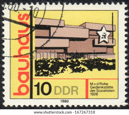 DDR- CIRCA 1980: A stamp printed in DDR  shows Memorial of Socialists, Bauhaus school, circa 1980  - stock photo