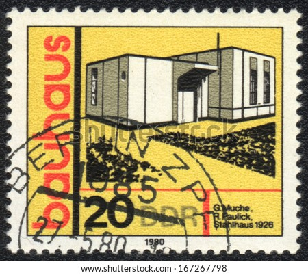 DDR- CIRCA 1980: A stamp printed in DDR  shows Steel house, Bauhaus school, circa 1980  - stock photo