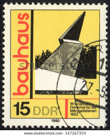 DDR- CIRCA 1980: A stamp printed in DDR  shows The Marzgefallenen Memorial, Bauhaus school, circa 1980  - stock photo