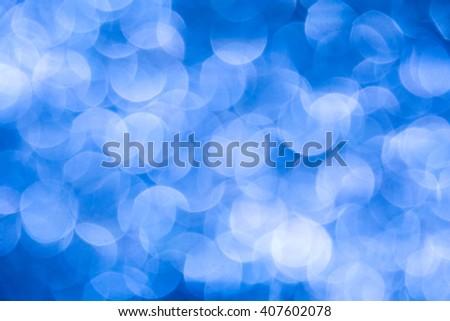 De-focused big light blue haze lights - abstract blue background - stock photo