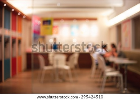 De focused/Blur image of a restaurant with a coupe of lovers in it. Blurred people in restaurant. Blurred background of lovers sitting in the restaurant.  - stock photo