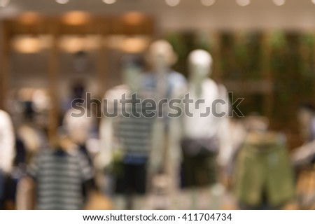 De focused/Blur image of boutique window with dressed mannequins. Boutique display window with mannequins in fashionable dresses. Toned image - stock photo