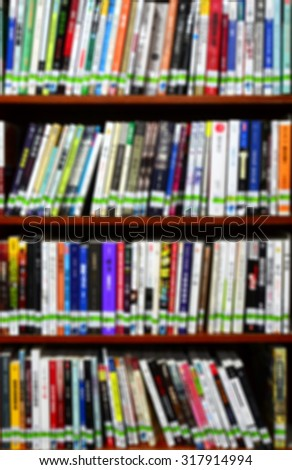De focused/ Blurred image of books on bookshelf in library