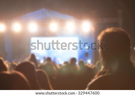 De-focused concert crowd. - stock photo