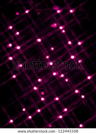 De focused image of pink neon lights over black background. - stock photo