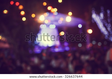 De-focused live concert festival during Christmas holidays event - in dreamy and vintage colour tone - stock photo