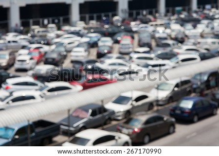 De-focused of a very crowded parking lot. - stock photo