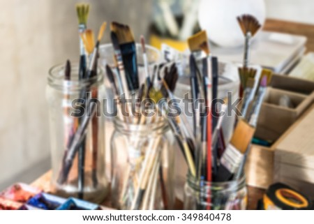 De focused or blurred image of painting brushes for art background - stock photo