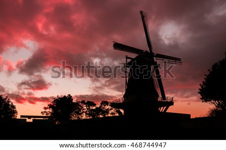 De Molen windmill of Foxton, New Zealand with a red cloud sunset.