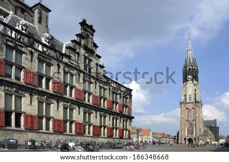 De New Church and the Townhall at the Market place of Delft. In this church the Dutch Royal Family is burried. - stock photo