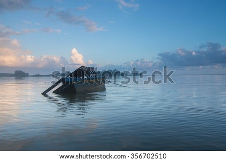 Dead boat in the beach during sunrise