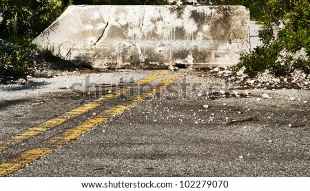 Dead end isolated road or street with a concrete barrier to prevent automotive traffic. - stock photo