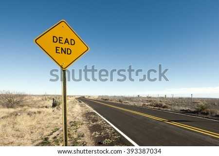 Dead end sign in the desert. - stock photo