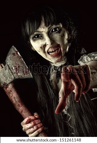 Dead female zombie with bloody axe extends hand to shot. Halloween concept. Evil ghost pointing at you - stock photo
