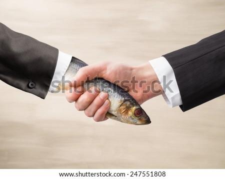 Dead Fish Handshake - stock photo