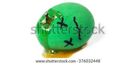 Dead green egg with broken shell letterbox - stock photo