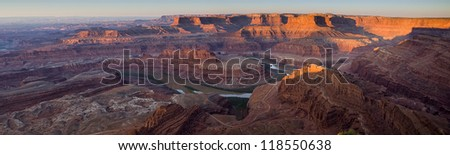 Dead Horse Point Panorama at Dawn.  This Utah park is near Moab and this vantage point provides a view of Canyonlands National Park and the Colorado River. - stock photo