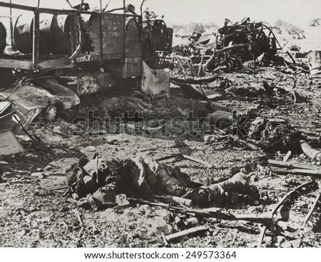 Dead Italian troops were transporting ammunition when struck by British artillery. Near Derna, Cyrenaica, during World War 2, ca. 1940-42. - stock photo