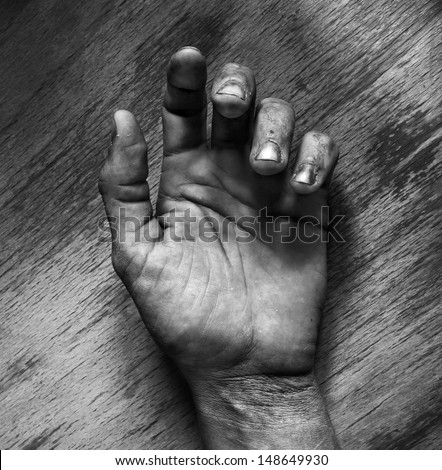 Dead man hand black and white - stock photo