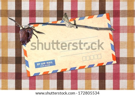 dead rose and mail envelope on table - stock photo