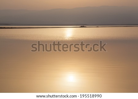 Dead Sea beautiful seascape with golden sunrise reflected in water. - stock photo