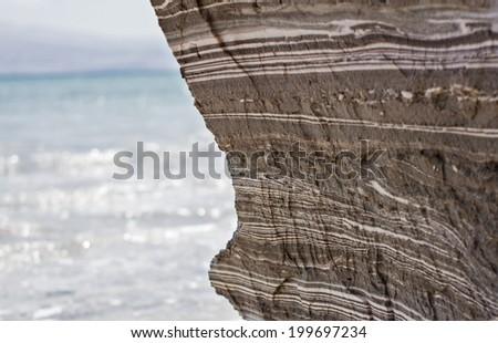 Dead Sea Mud on the coast of the Dead Sea , Israel . - stock photo