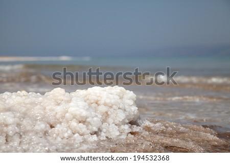 Dead Sea salt closeup on the blurry background - stock photo