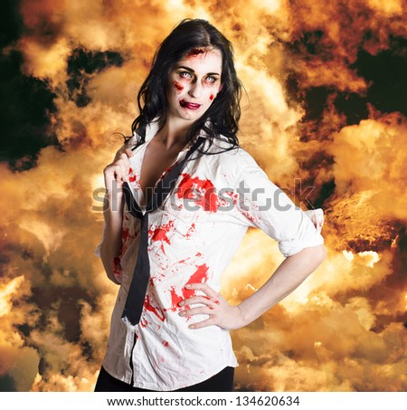Dead sexy business woman standing in flames of desire in a depiction of the deadly sin LUST - stock photo