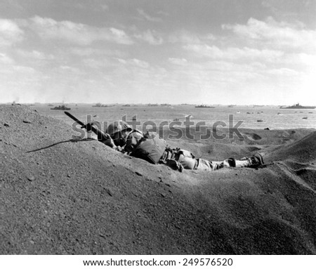 Dead U.S. Marine, his bayonet fixed, was killed by intense Japanese sniper fire on Iwo Jima. Feb. 19, 1945. - stock photo