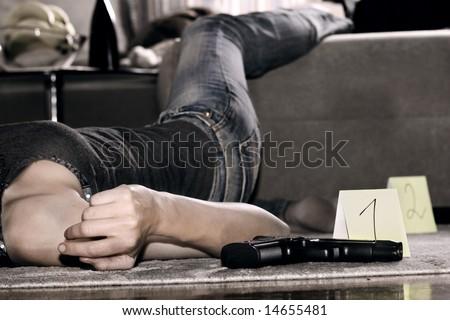 dead woman lying on the floor, gun on the floor - stock photo