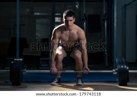 Deadlift - Muscular Man Lifting Deadlift In The Gym - stock photo