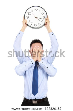 deadline concept of businessman with many hands holding clock and covering face isolated on white background