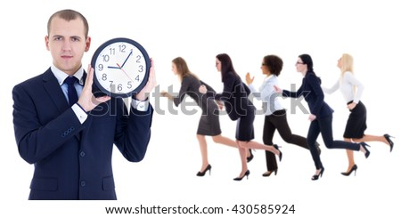 deadline concept - young businessman holding office clock and running people isolated on white background