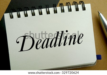 Deadline memo written on a notebook with pen